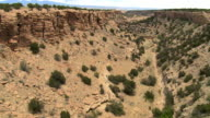 Flight above a dry stream bed in a desert canyon