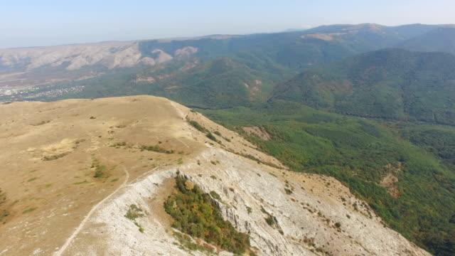 AERIAL: Flight above mountain plateau