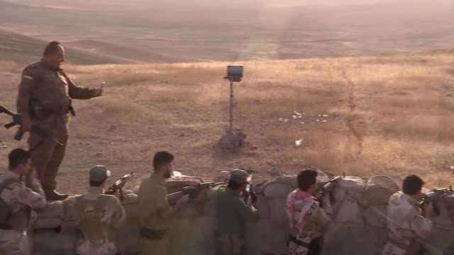 Flight ban after Kurdish freedom vote NORTHERN Kurdish fighter stands on tank on skyline with Kurdistan flag flying Kurish fighters Peshmerga pose...
