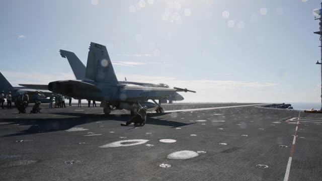 Flight operations footage from USS Gerald R Ford with F/A18 Super Hornets and SH60 Seahawk