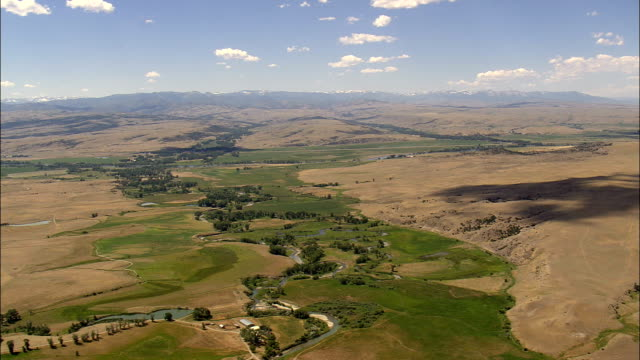 Flight Over Cloud Shadows To Yellowstone River  - Aerial View - Montana, Sweet Grass County, United States