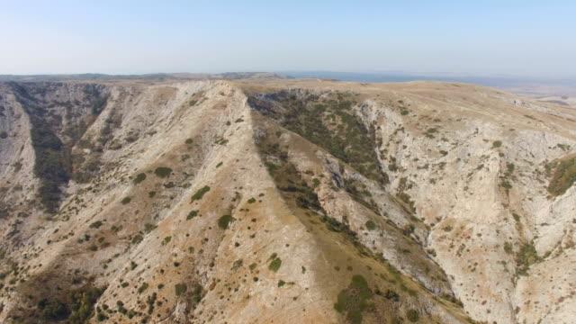 AERIAL: Flight over mountain plateau