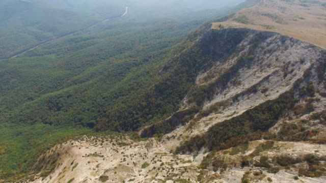 AERIAL: Flight over plateau in mountains