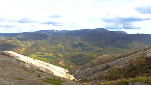 AERIAL: Flight over plateau slopes
