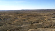 Flight Past Butte And Over Grassland  - Aerial View - Wyoming, Weston County, United States