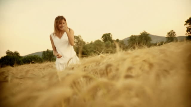 HD SLOW-MOTION: Flirty Woman In Wheat