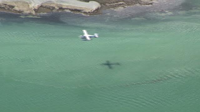 WS, HA, Float plane flying above sea, Juneau, Alaska, USA