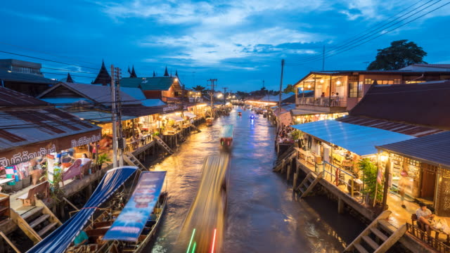 Floating Market at Dusk,Amphawa floating market in Thailand