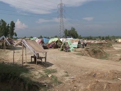 Flood survivors seek shelter at makeshift encampment following severe rains and flooding in Pakistan