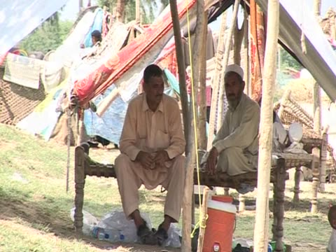 Flood victims seek shelter at makeshift encampment following severe rains and flooding in Pakistan