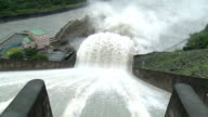 Flood Water Flows Down Spillway Of Hydroelectric Dam