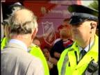 Aftermath Prince Charles visits Catcliffe Prince Charles talking to police and NHS paramedics / View on digital camera screen as Charles talking to...