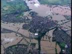 Air views of Eynsham Evesham and Tewkesbury AIR VIEWs of flooded caravan park with Tewkesbury Abbey in foreground / Tewkesbury Abbey surrounded on...