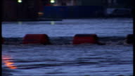 Flooding in Leeds EVENING General views of swollen River Aire flowing past warehouse buildings and under bridge buoys floating Flooded city areas...