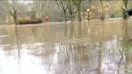 Keynsham ENGLAND Somerset Keynsham EXT Car standing in flooded area / Sign 'Danger Deep Water' standing in floodwater of swollen river / picnic...