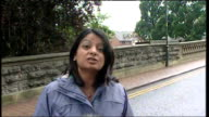 Large areas of Britain still badly affected ENGLAND Worcestershire Evesham EXT Reporter LIVE to camera PAN high floodwater gushing down street past...