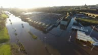 Flooding misery continues in the North of England Leeds View over area flooded when the River Aire burst it's banks Drone footage of flooded street