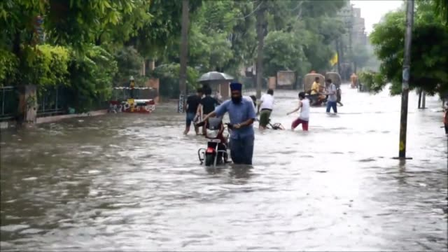 Floods hit Amritsar in northwest India after a heavy monsoon downpour CLEAN Flood hits India during annual monsoon on August 07 2013 in Amritsar India