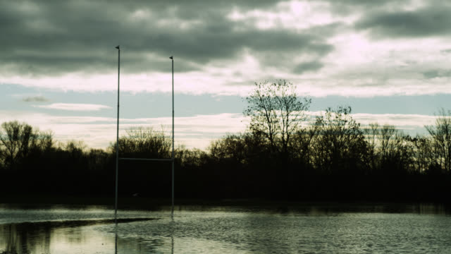 Floodwater surrounds rugby pitch and goal posts, Upton-Upon-Severn, Worcestershire, England