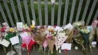 TU Floral tributes for murdered teacher Anne Maguire line the perimeter fence outside Corpus Christi Catholic College in Neville Road on April 29...