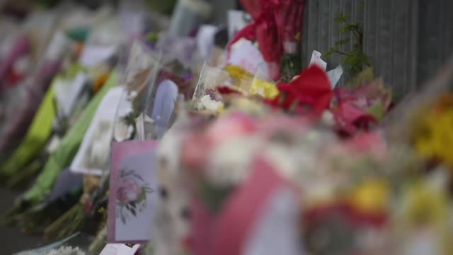 PFS Floral tributes for murdered teacher Anne Maguire line the perimeter fence outside Corpus Christi Catholic College in Neville Road on April 29...