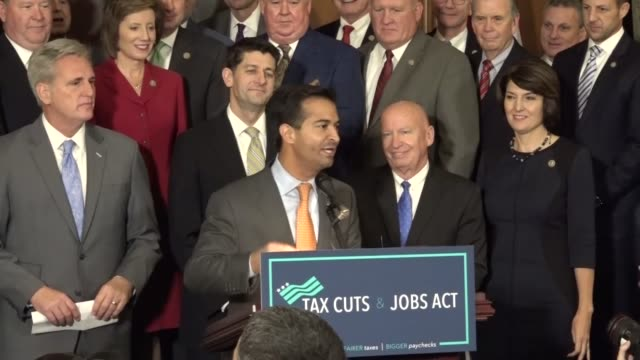 Florida Congressman Carlos Curbelo begins a news conference with House Republicans after initial passage of the Tax Cuts and Jobs Act calling it one...