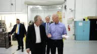 Florida Governor Rick Scott with Aerospace CEO Pierre Pinsonnautt during a news conference at Aerospace Precision Gov Rick Scott tour the facility to...