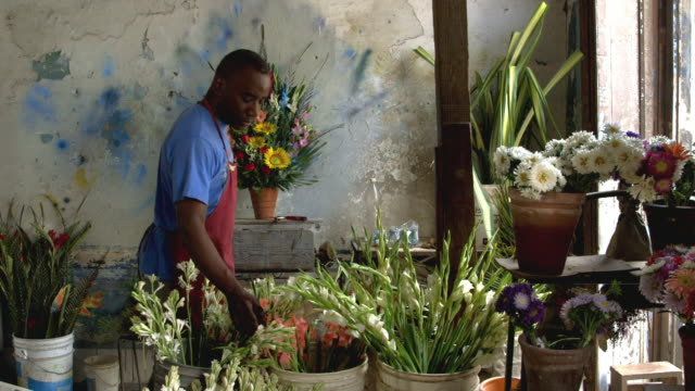 MS A florist prepares a bouquet in his shop / Havana, Cuba