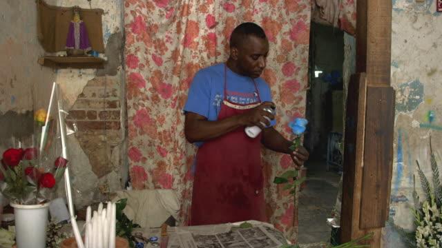 MS A florist prepares a rose in his shop / Havana, Cuba