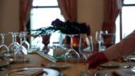 Flower arrangement for an indoor ballroom wedding table decoration