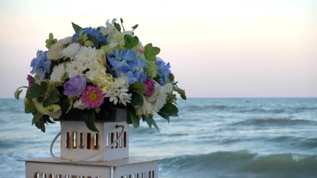 Flower vase on the beach