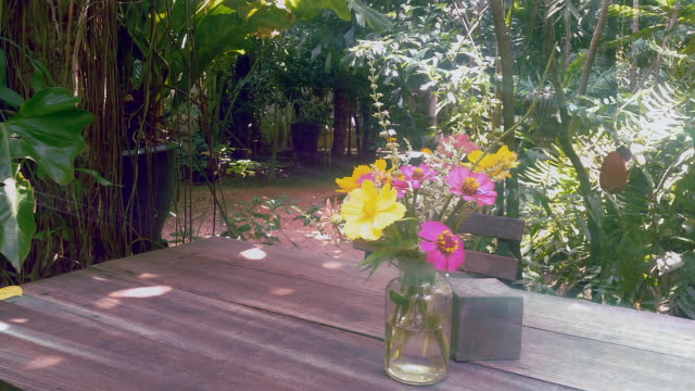 flowers in vase on table in the garden