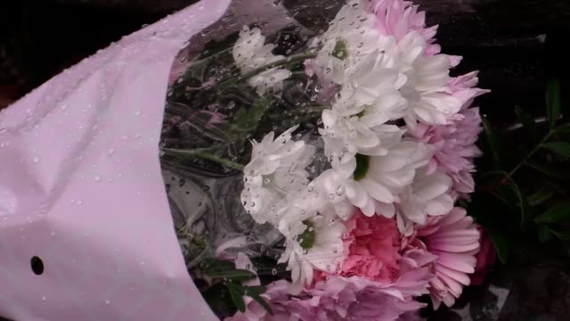 Flowers left close to the scene in Llangammarch Wells Powys after several members of a family are feared dead after a blaze ripped through a...
