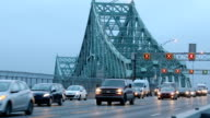 Flowing traffic on Montreal Jacques-Cartier bridge at dawn Zoom out version HD