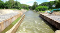 Flowing water at floodgate,Tilt Down