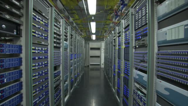 Fluorescent lights hang above a computer server room in London.