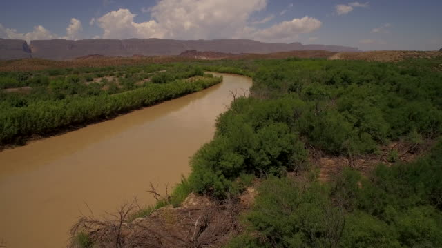 Fly low along Rio Grande River from Big Bend National Park Texas looking at Mexico