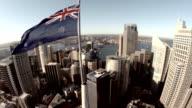 Fly over Sydney CBD past Australian Flag