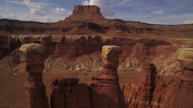 Fly past towering rock at Cannyonlands National Park Utah