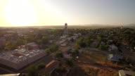 Fly towards Marfa water tower Texas