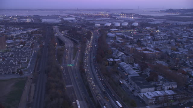 Flying above the New Jersey Turnpike at dusk, Newark Bay and New York City in distance. Shot in 2011.