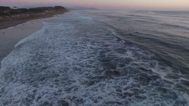 Flying Along Beach At Sunset