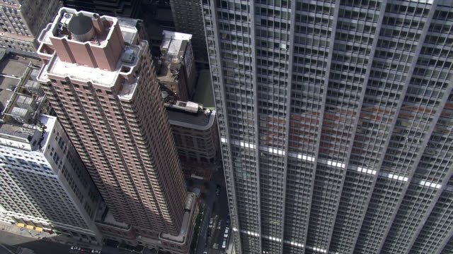 Flying among tall buildings of New York's Financial District. Shot in 2006.