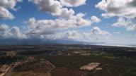 Flying inland over Ewa Gentry, Oahu; Diamond Head in distance