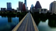 Flying Low Next to Congress bridge backing away from Austin Texas North Downtown Aerial Drone