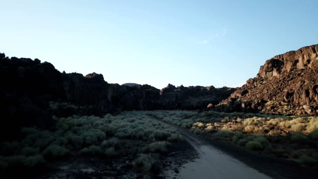 Flying Low Through Ancient Riverbed of Volcanic Rocks