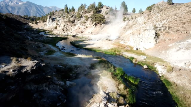 Flying Low Through Riverbed Over Hot Springs
