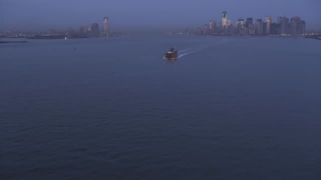 Flying over a ferryboat toward Lower Manhattan at dusk, Jersey City skyline at left. Shot in 2011.