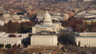 Flying over Capitol Hill from South Capitol Street to Pennsylvania Avenue with Rayburn House Office Building in front of Capitol. Shot in 2011.