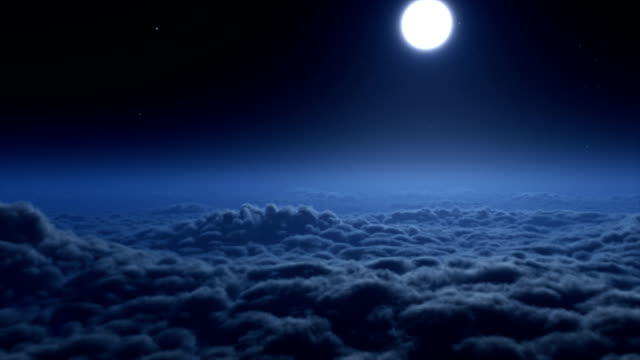 Flying over clouds at night